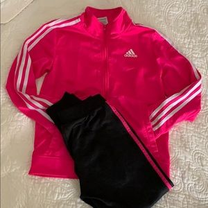 A Adidas hot pink and black sweatsuit for girls.